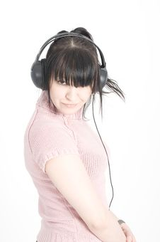 Beautiful Brunette Girl Is Listening To Music Stock Photos