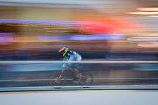 Free Biker Streaking Past Blurred Background Stock Photo - 88038670
