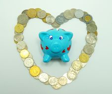 Free Piggy Bank With Coins Royalty Free Stock Photo - 8810075