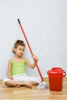 Little Girl Cleaning The Floor Royalty Free Stock Image