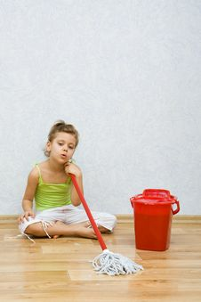 Little Girl Cleaning The Floor Stock Photography