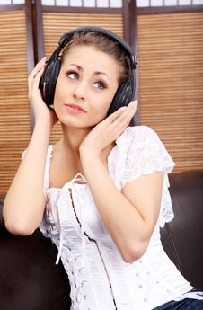 Free Young Sexy Women Listening Music In Headphones Stock Photography - 8813042