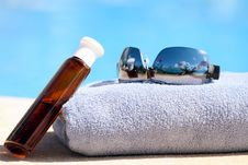 Sunglasses, Towel And Oil Bottle Stock Photos