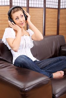 Free Young Sexy Women Listening Music In Headphones Royalty Free Stock Photo - 8813545