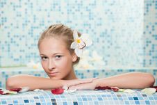 The Young Beautiful Girl Floating In Pool Royalty Free Stock Images