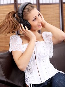 Free Young Sexy Women Listening Music In Headphones Royalty Free Stock Images - 8813819