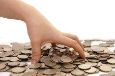 Female Hand Takes Some Coins Stock Photo