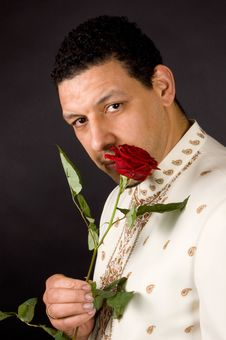 Free Aruban Male Is Smelling A Beautiful Red Rose Stock Images - 8817364