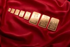 Free Gold Bars On Red Velvet Stock Images - 88103424