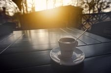 Free Coffee Cup On Table At Sunrise Stock Image - 88104011