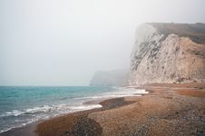 Free Ocean Beach With Cliffs Royalty Free Stock Photo - 88188035