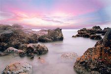 Free Rocky Beach At Dusk Royalty Free Stock Photo - 88192815