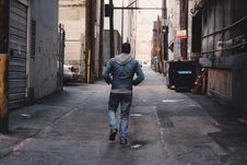 Free Man Walking In Alleyway Royalty Free Stock Photos - 88192998