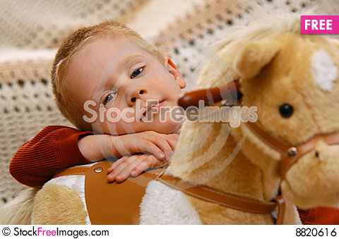Boy With Toy Horse Stock Photo