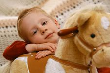 Free Boy With Toy Horse Royalty Free Stock Image - 8820616