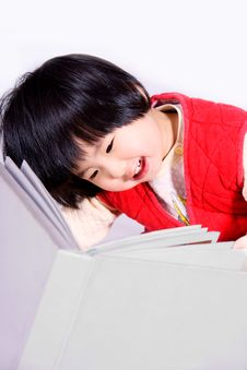 Free Girl Reading Book And Laughing Stock Images - 8821074