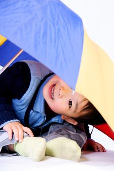 Boy Under Unbrella Stock Image