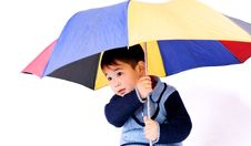 Boy Under Unbrella Royalty Free Stock Photos