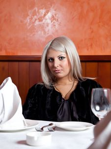 Free Charming Blond Girl Sitting At A Table Stock Photography - 8821892