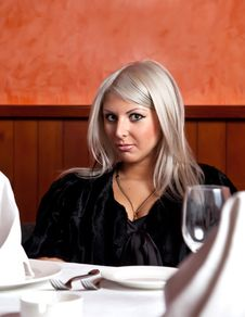 Free Charming Blond Girl Sitting At A Table Stock Photography - 8821902