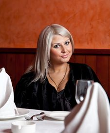 Free Charming Blond Girl Sitting At A Table Stock Image - 8821911