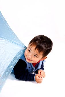 Boy Under Unbrella Royalty Free Stock Photo
