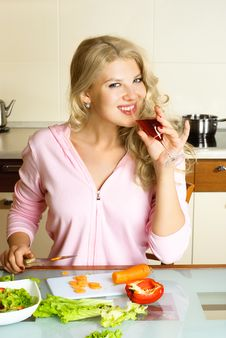 Pretty Girl Making Salad Stock Images