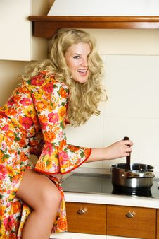 Happy Girl Cooking Dinner Stock Photography