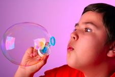 Free Boy Blowing Soap Bubbles Stock Photo - 8825040