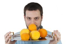 Free Man With A Plate Full Of Tropical Fruit Stock Photos - 8825423