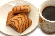 Kind With Top On Coffee Plate With Cookies Stock Photos