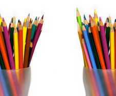 Colored Pencils In Two Glasses Royalty Free Stock Photos