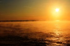 Free Sunset Over A Mist Covered Ocean Royalty Free Stock Photography - 88262357