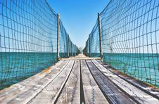 Free Fenced Wooden Boardwalk Over Ocean Stock Photography - 88262672