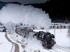 Free Steam Engine Train On Snowy Tracks Stock Photo - 88264260