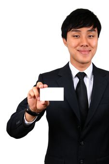 Free Young Asian Business Man Holding A Name Card. Royalty Free Stock Photos - 8832928