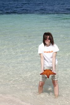 Woman Holding Starfish