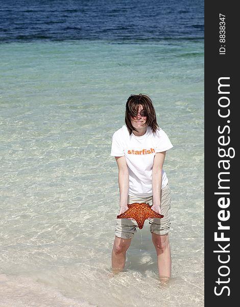 Woman holding starfish