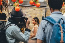 Free Man Wearing Grey Fedora Hat Taking Picture Of Woman In White Sleeveless Top Royalty Free Stock Images - 88327699
