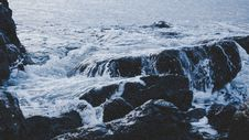 Free Waves Over Rocky Shores Stock Photography - 88329022