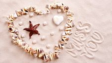 Free Seashell Heart In Sand Stock Photo - 88329100