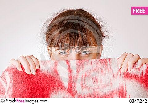 Girl face hiding behind a towel Stock Photo