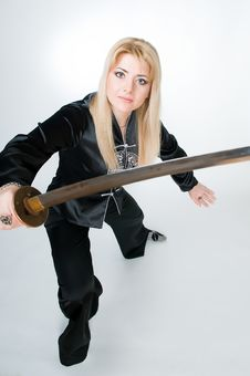 Free Woman In Japanese Shirt With Sword Stock Photography - 8843042