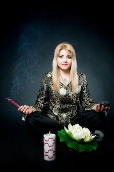 Woman Meditating In Lotus Pose Royalty Free Stock Image