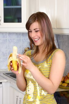 Free Young Woman In Her Kitchen Stock Images - 8843224