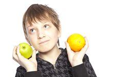 Boy Holding Apple And Orange Stock Image