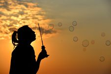 Free Girl Blowing Bubbles At Sunset Royalty Free Stock Photo - 88417405