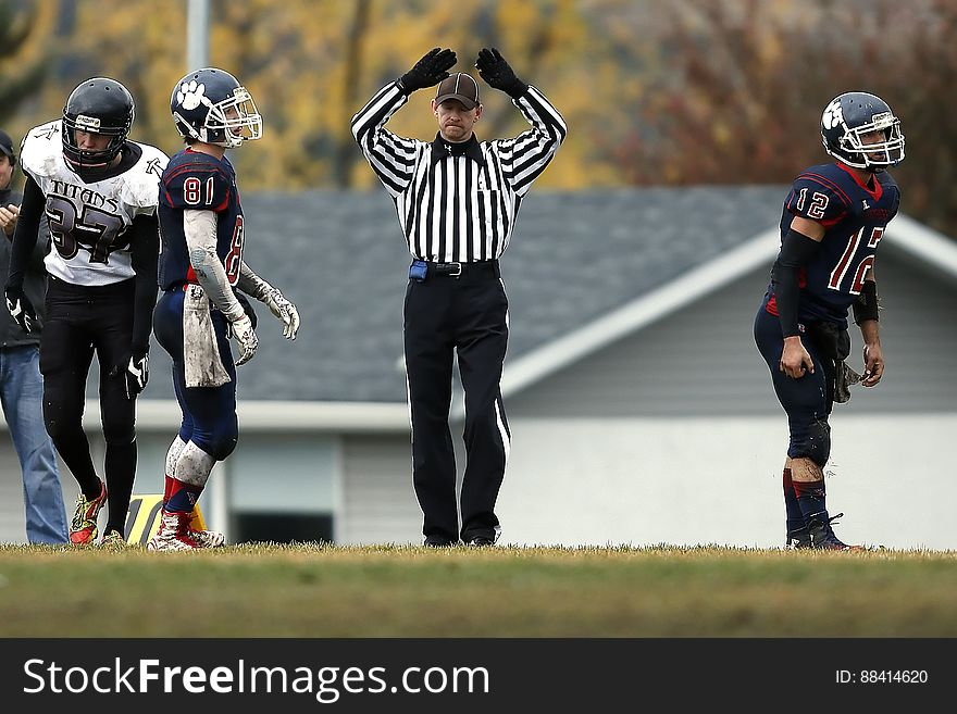 Referee Between 3 Football Player