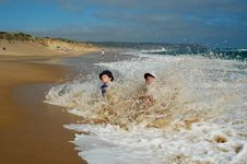 Free Boys Splashing In Waves Royalty Free Stock Images - 88492449