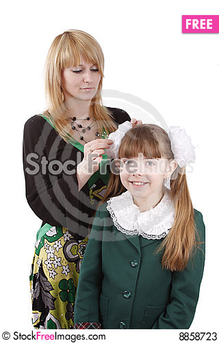 Free Mother Is Helping Daughter Prepare To School. Stock Photos - 8858723